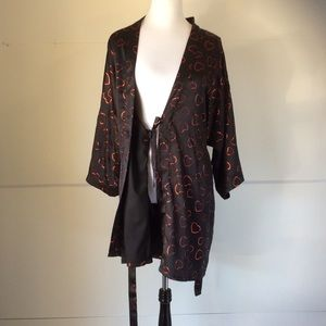 Silky black robe with red hearts